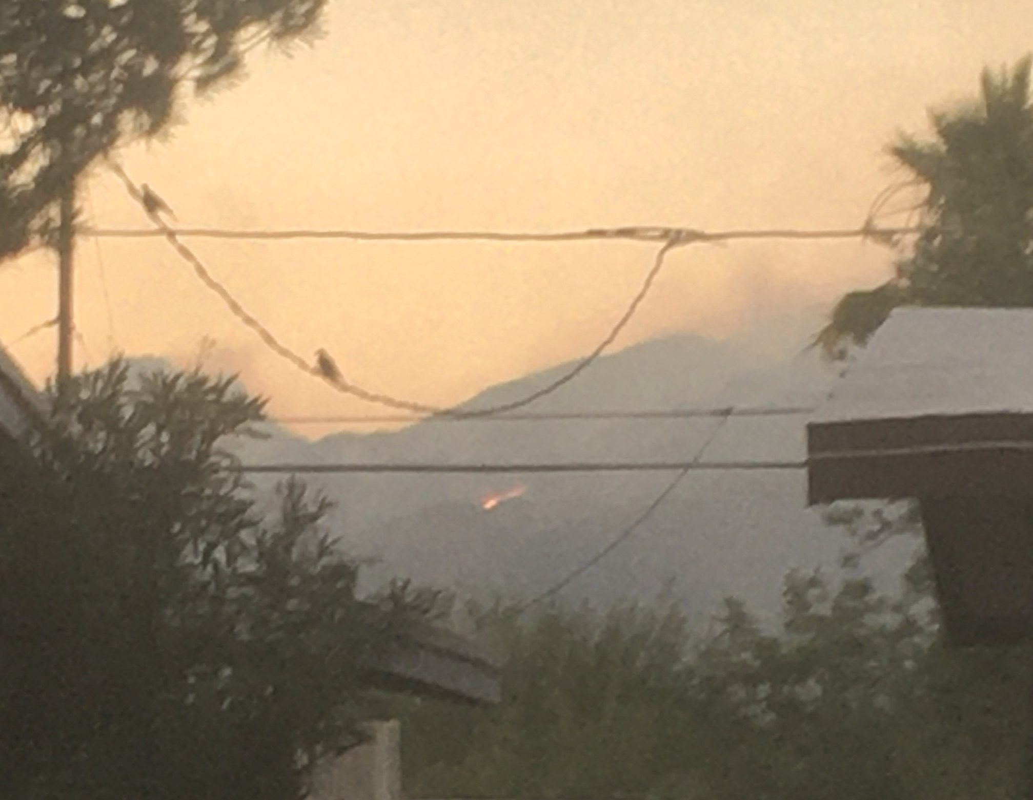 [Smoke over the Catalina Mountains at sunset]