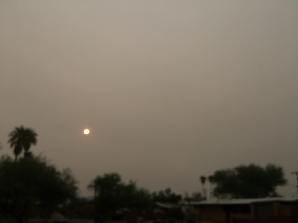[Sun through wildfire haze]