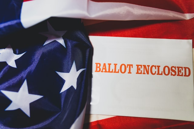 [Image of ballot and flag]